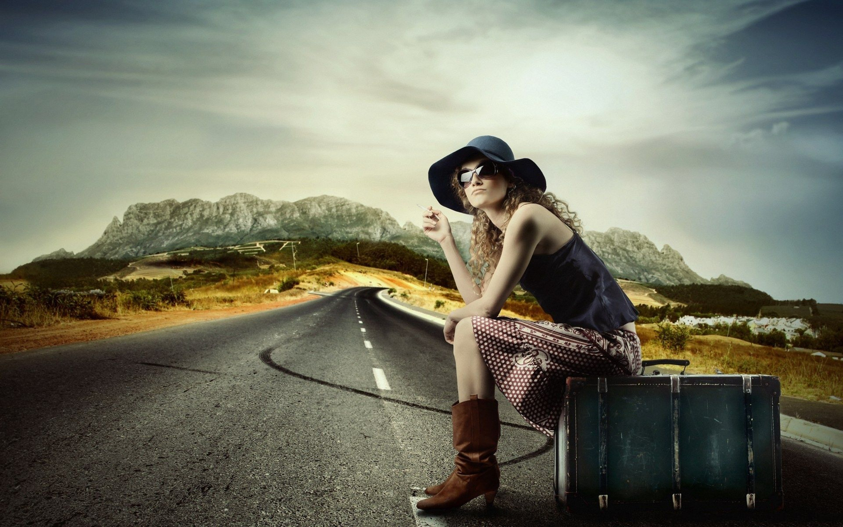 Girl on the road hitchhiking