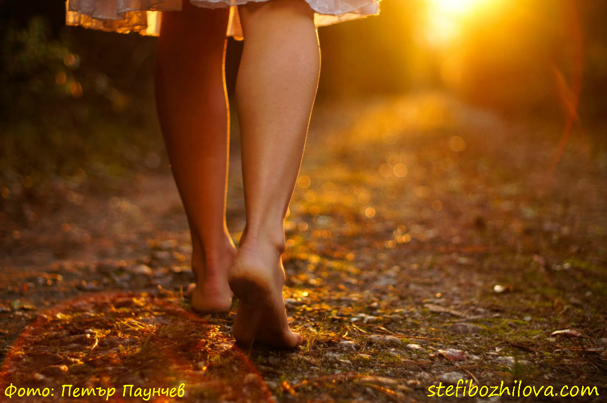 Girl walking barefoot towards light